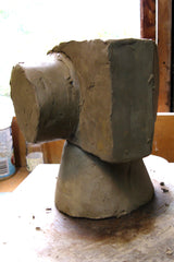 Clay sculpture split into sections. Stephen Williams