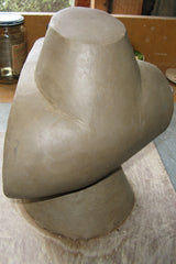 Clay sculpture with top section. Stephen Williams