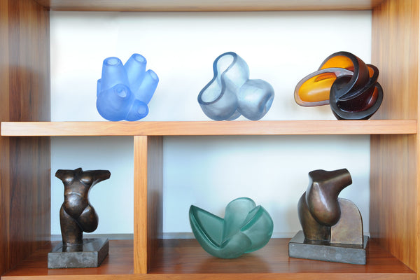 Cast glass and bronze sculptures on shelves. Stephen Williams