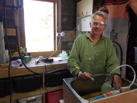 Stephen Williams ready to cold work his cast glass sculpture.
