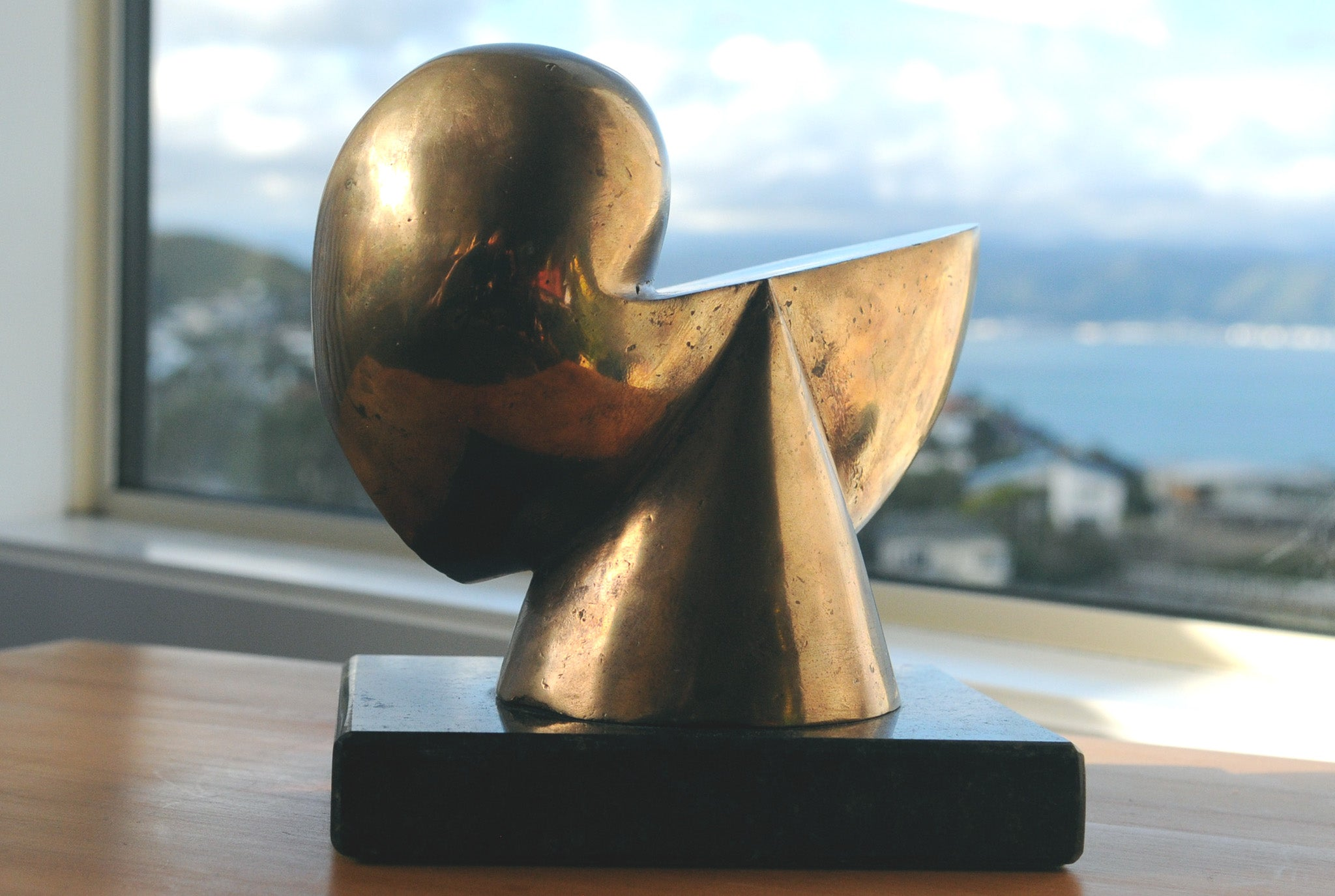 Abstract bronze sculpture by Stephen Williams.
