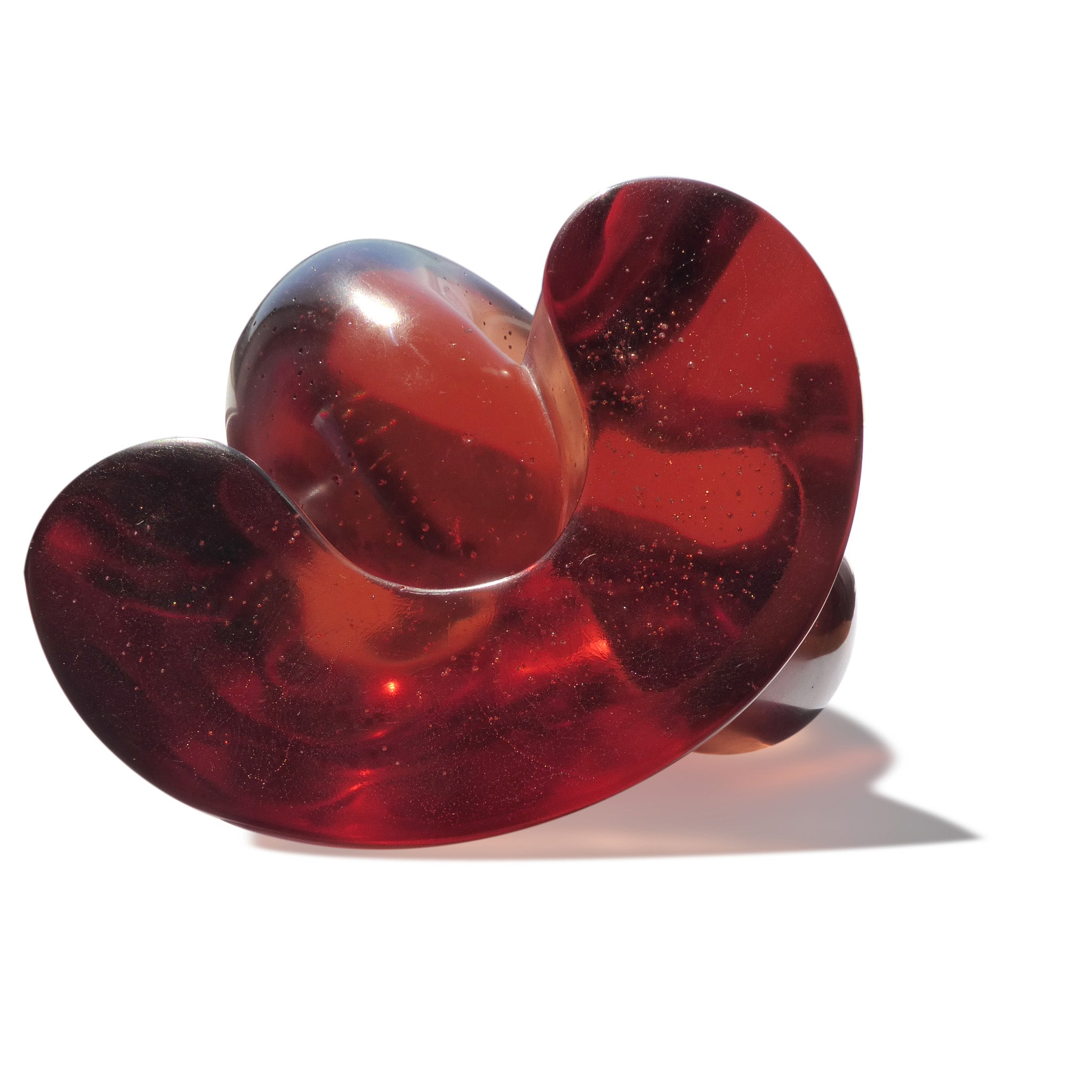Abstract polished cast glass sculpture of red blood cells by Stephen Williams.