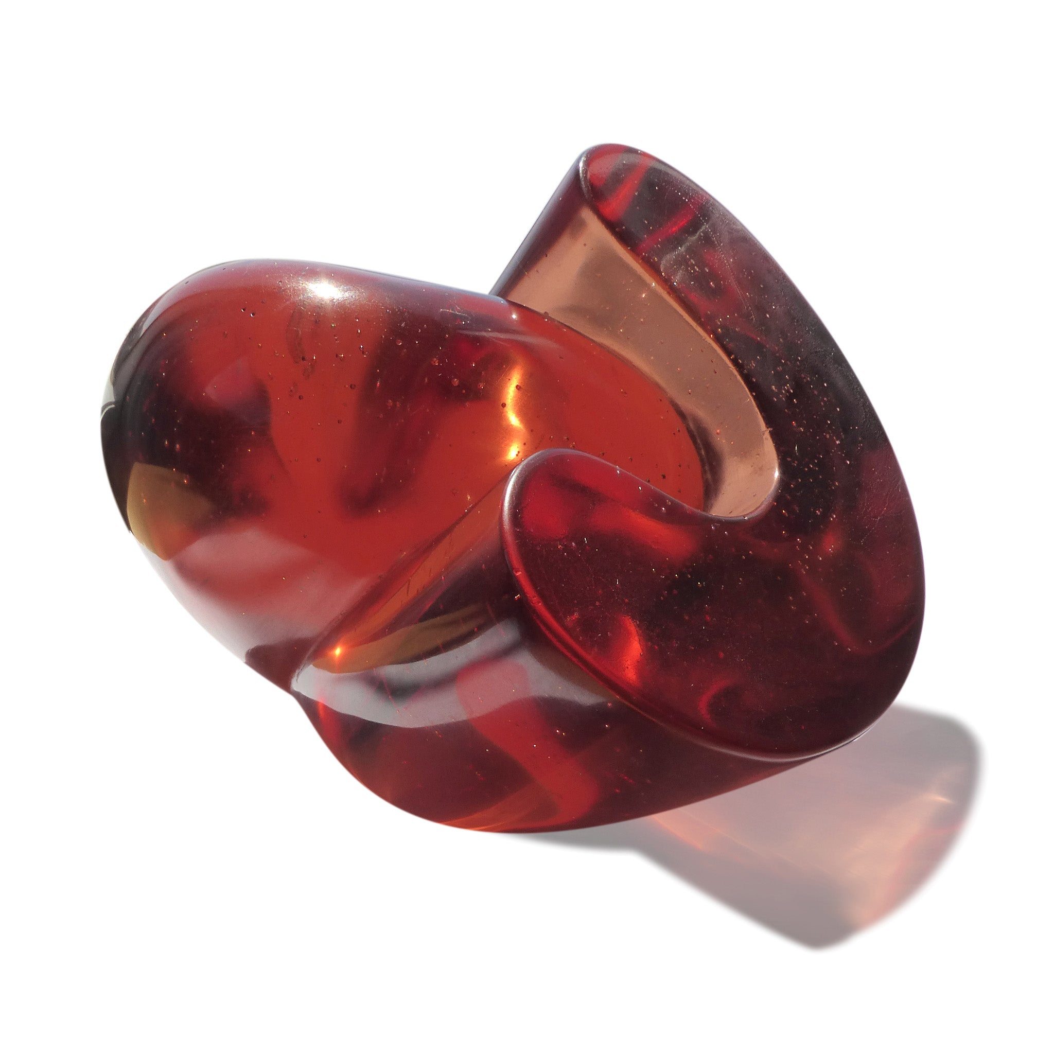 Abstract polished cast glass sculpture of red blood cells by Stephen Williams | New Zealand.
