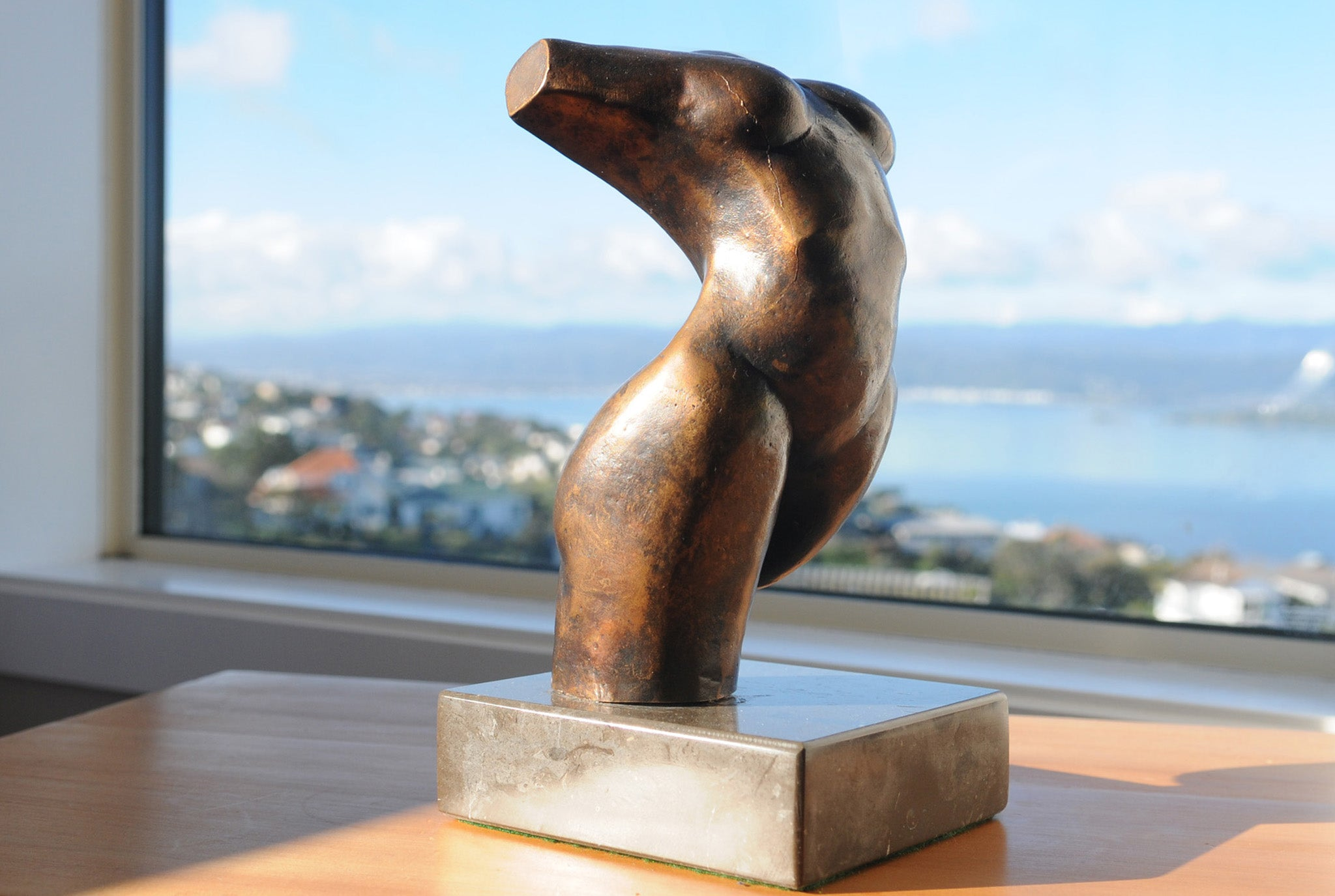 Abstract figurative bronze sculpture by Stephen Williams.