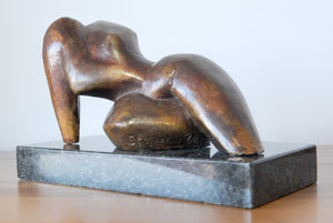 Reclining bronze abstract figure sculpture by Stephen Williams