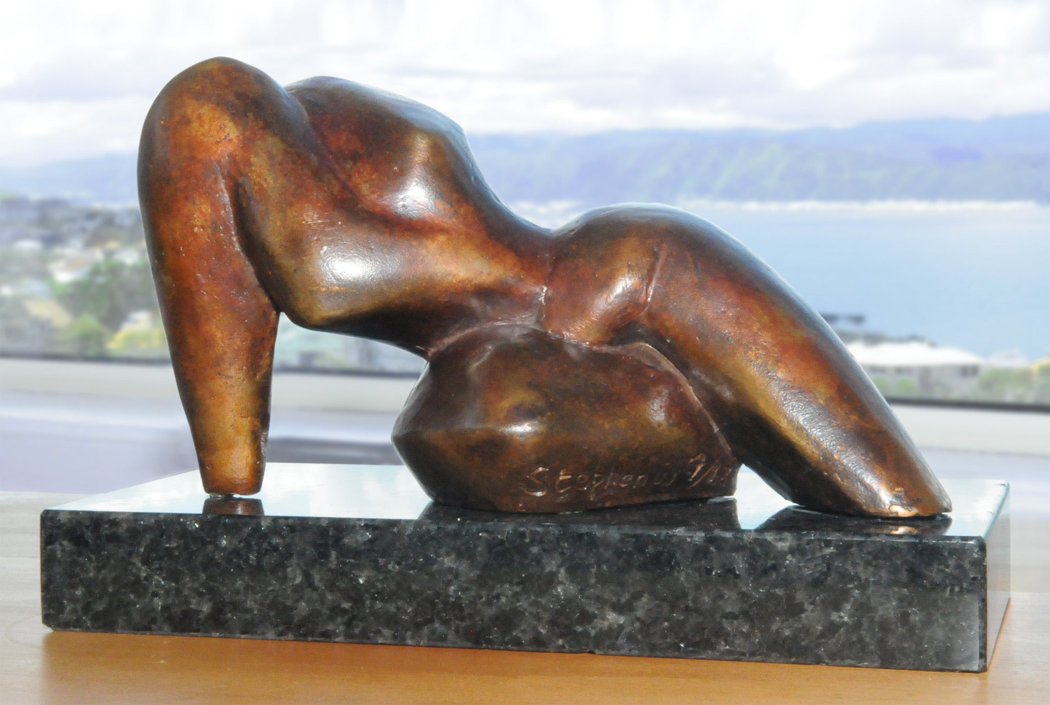 Reclining abstract figurative bronze sculpture by Stephen Williams | New Zealand.