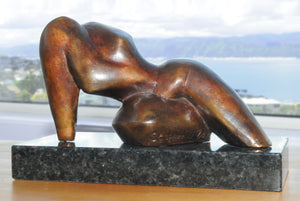 Reclining abstract figurative bronze sculpture by Stephen Williams