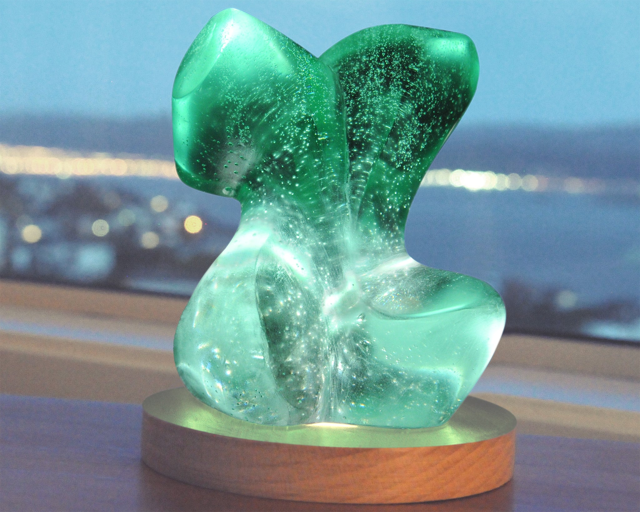 Abstract female figurative cast glass sculpture with light by Stephen Williams.