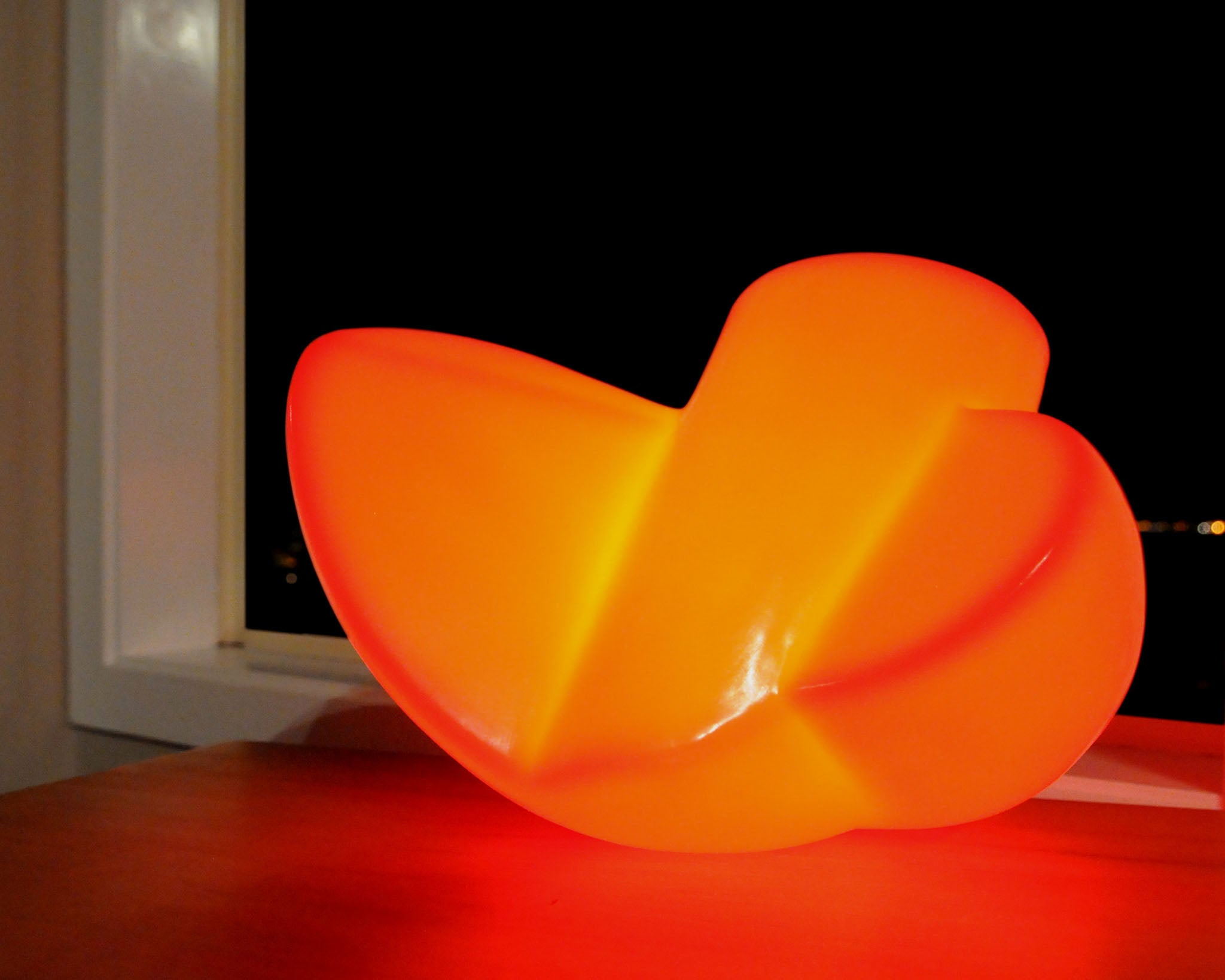 Twist - Red polyethylene table lamp sculpture for sale by Stephen Williams