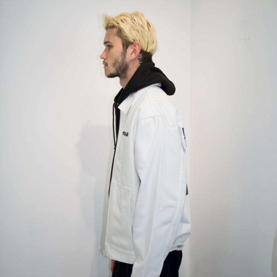 polar skate co notes jacket in white denim seen from left side