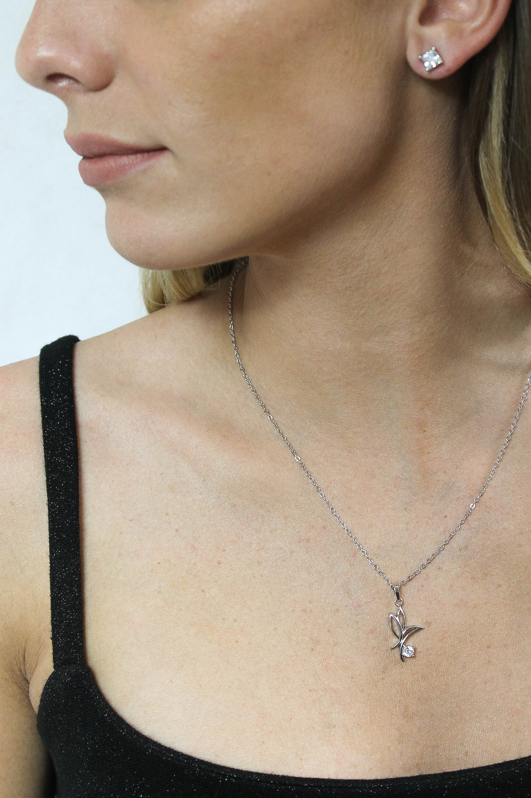 butterfly pendant necklace in gold or silver with cubic zirconia crystal