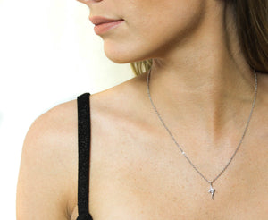 Eye shaped pendant necklace in gold and silver colours with cubic zirconia crystal