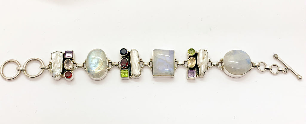 Moonstone Bracelet With Garnet,Peridot, Amethyst,Mother of pearl $210