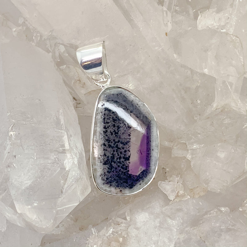 Merlinite Pendant With Amethyst $140