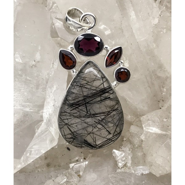 Tourmalinated Quartz Pendant With Garnet $110