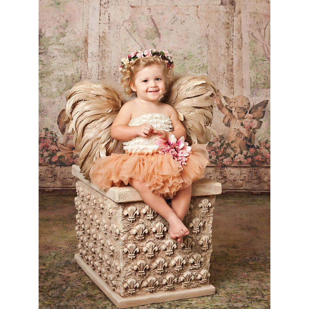 Fleur De Lis Prop with girl sitting on bench