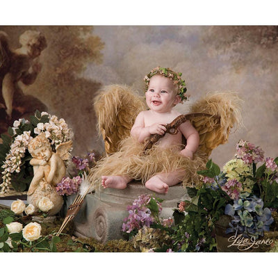 baby with angel wings sitting on pedestal prop
