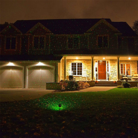 Image of PopStars: Christmas Laser projector illuminating your house facade - Beeline-Xpress