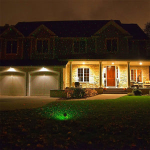 PopStars: Christmas Laser projector illuminating your house facade - Beeline-Xpress