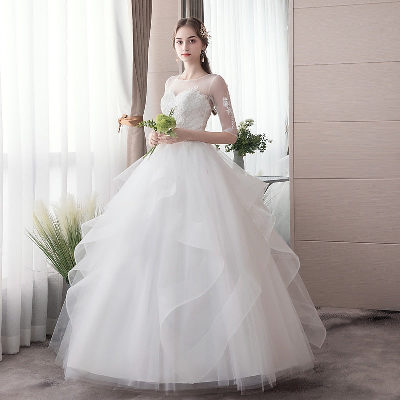 Wedding dress with multi-tiered skirt