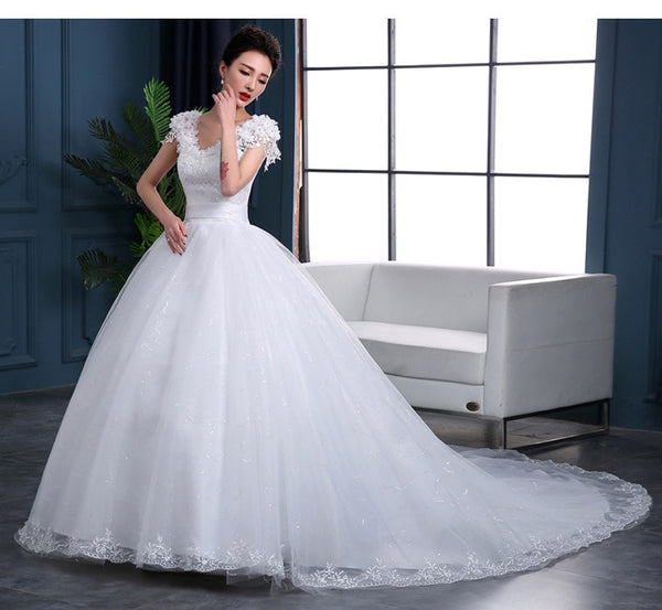 A-Line Wedding Dress with Cap Sleeves and a Train