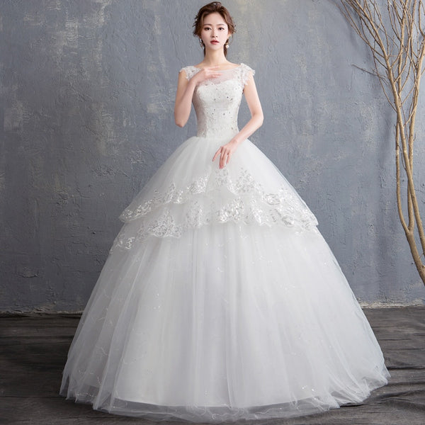 High-Neck Wedding Gown with a Multi-Tiered Skirt