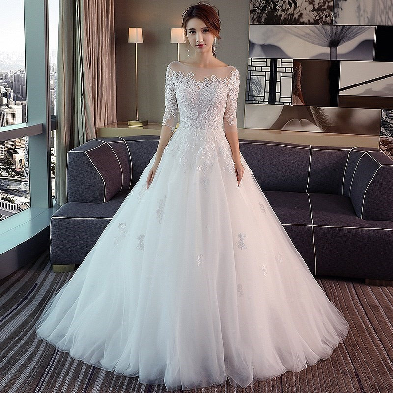 Wedding dress with illusion bodice and sleeves