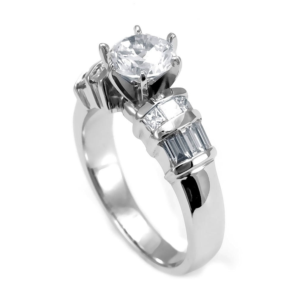 A combination of Baguette and Princess Cut Diamonds in an 18K White Gold Engagement Ring