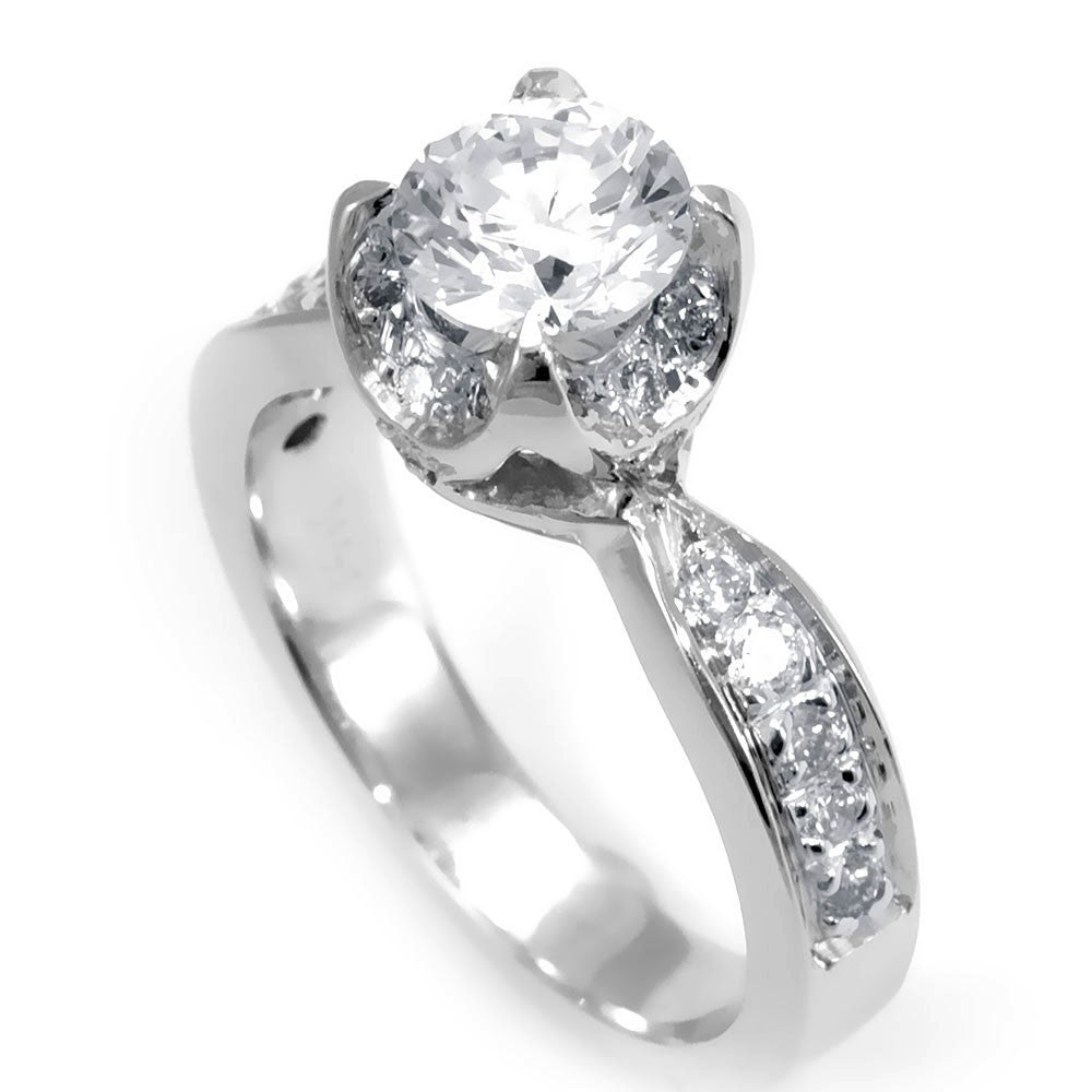 A simple design of an Engagement Ring in 14K White Gold with pave set Round Diamonds