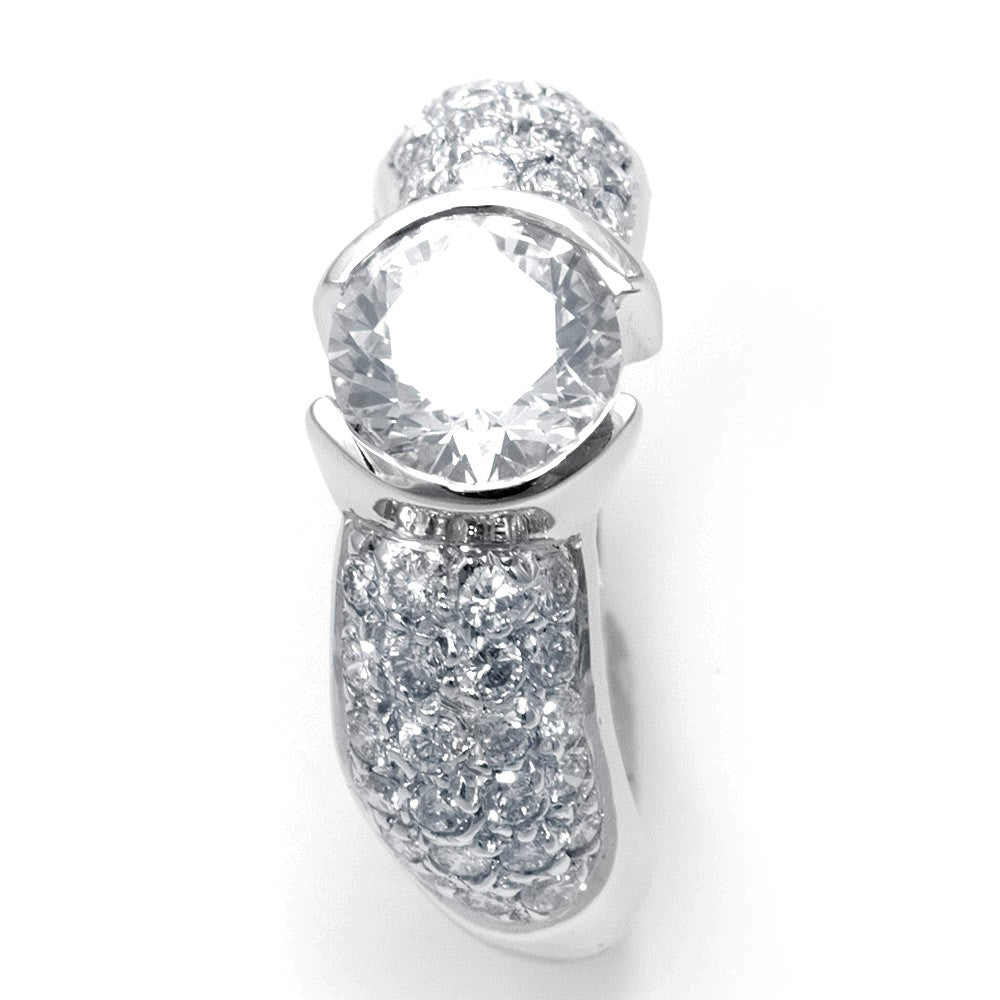 A bezel set center Engagement Ring with pave set Round Diamonds in 14K White Gold