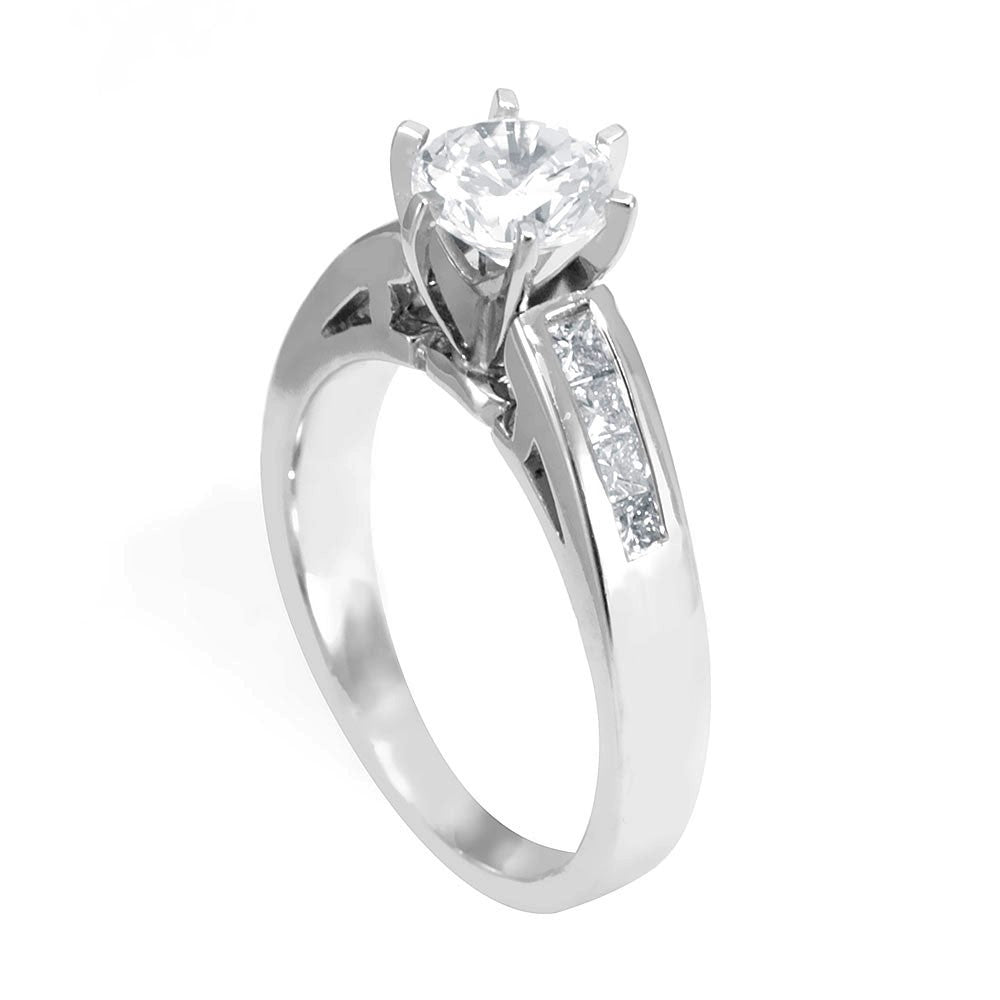 A simple design of an Engagement Ring in 14K White Gold with Princess Cut Diamonds
