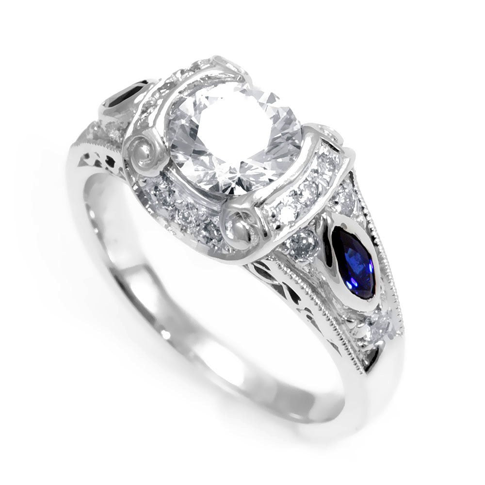 A unique Design 18K White Gold Engagement Ring with Round Diamonds and Blue Sapphire