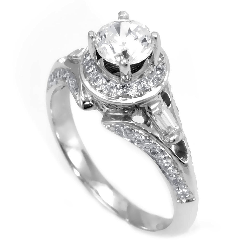 An 18K White Gold Engagement Ring with combination of Baguette and Round Diamonds and CZ center stone