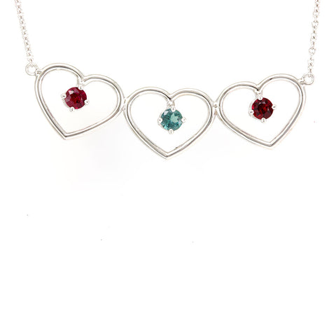 Rubies and Aquamarine Triple Heart necklace in 14K White Gold