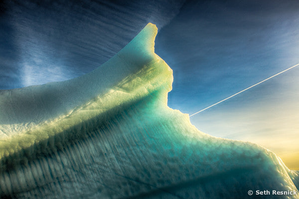 Contrail over berg, Greenland