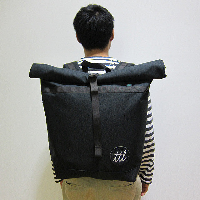 turntable lab rolltop bag on shoulder