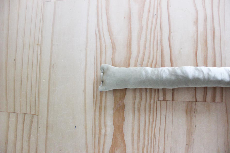 Take the long curler tube and fold the short raw edges inside on one end only and sew this one end shut.