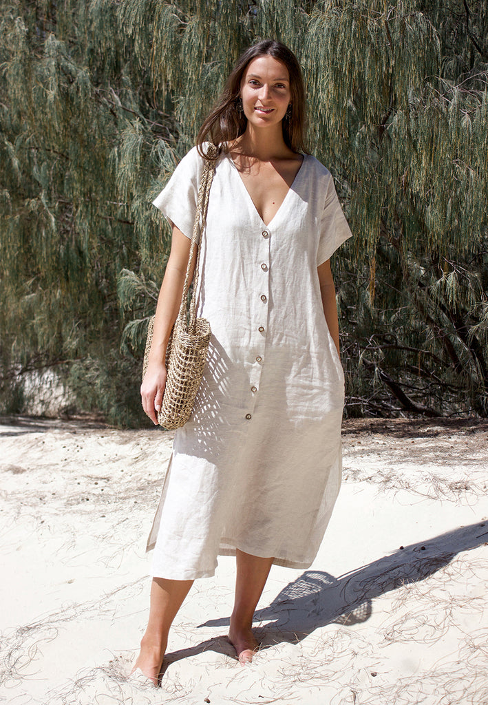 The Adelia Dress is a loose fitting linen sewing pattern design with button down front, side splits, and in seam pockets. Sew it in 2 lengths, midi or mini.