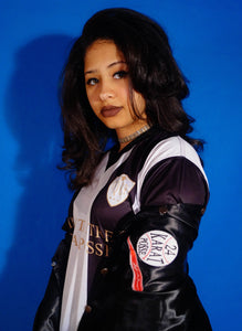 Girl wearing 24 Karat Posse Soccer Jersey and Baseball Jacket
