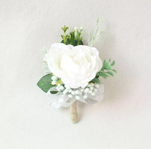 White Boutonniere and Corsage With Greenery