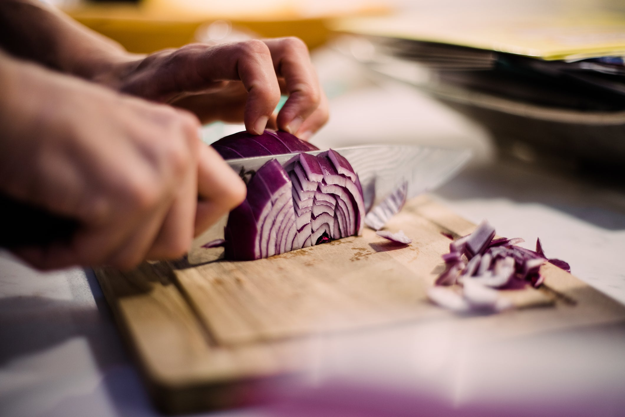 Cutting onion with chefs knife