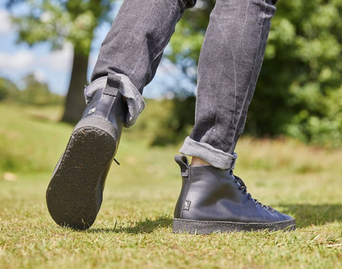 Black Yogi Footwear boots in a field