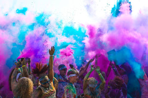 pink blue color powder being thrown in air