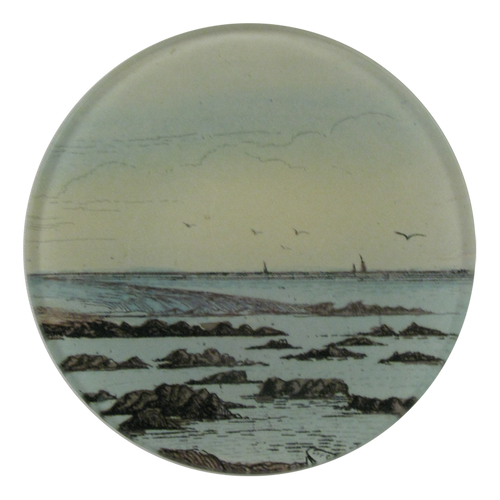 A four inch round handmade decoupage plate titled The Shore