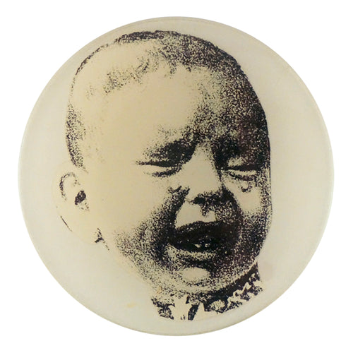 A four inch round decoupage plate titled Crying Baby (Right)