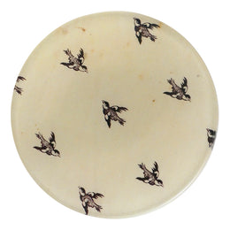 A four inch round handmade decoupage plate titled In Flight