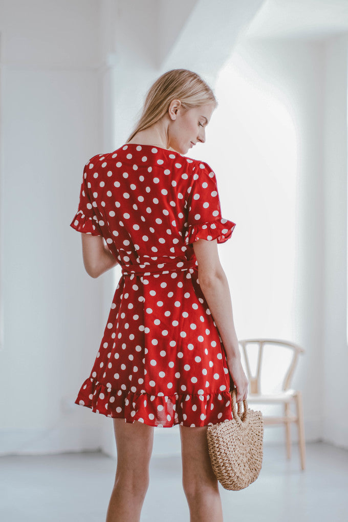 Goodnight Macaroon 'Victoria' Red Polka Dot Ruffle Wrap Dress Model Half Body Back