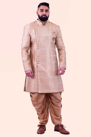 Exquisite antique gold silk blended sherwani with golden buttons for sophisticated and luxe touch, paid with dhoti pants.