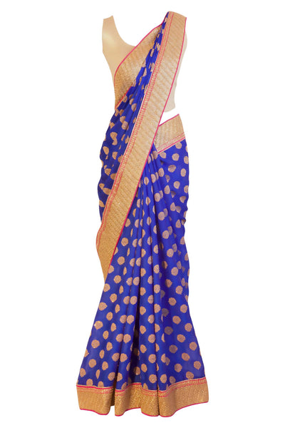 Royal blue chiffon sari with gold pin wheels embroidery. Heavy gold border with pink trim.