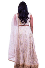 Classy white blouse with sequin embroidery, paired with bedazzled white skirt for extra shine. Finished with bordered net dupatta.